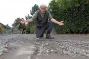 "Upton man labels potholed road a ""disgrace"""